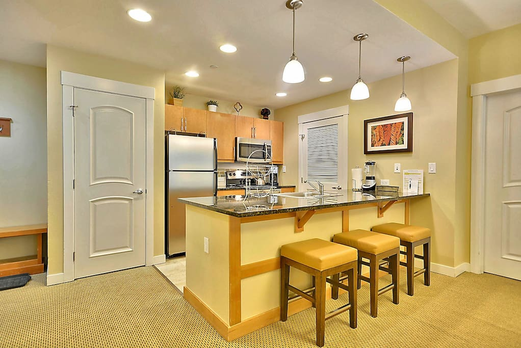 Granite Counter Top and Comfortable Bar Stools