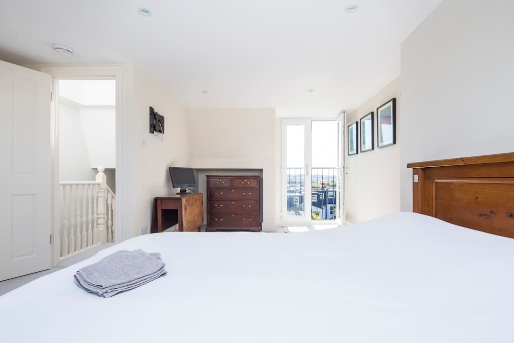 Huge south facing bedroom with large double doors overlooking Wimbledon in the distance.