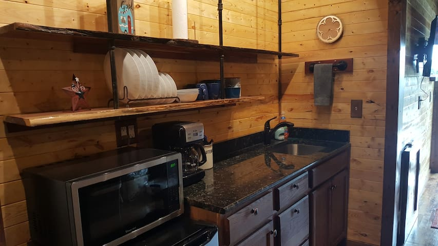Kitchenette with microwave, mini-fridge, sink, and coffee maker