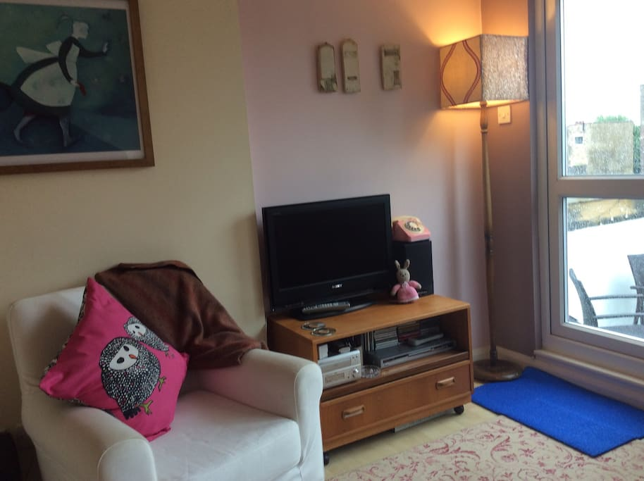 Top floor lounge has vintage armchairs and modern TV with freeview and Chromecast. CD and DVD players with a range of music and movies available.