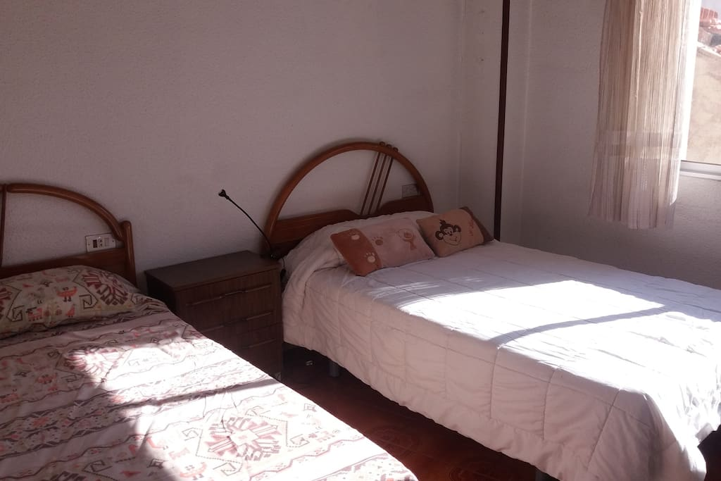 Bedroom with 2 single beds. As you can see, all the rooms have a lot of light.