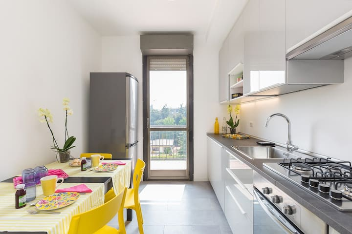 The kitchen is fully equipped: fridge with big refrigerator, gas stove, electric oven, dishwasher, big table with chairs, cupboard, pans, dishes, etc. A terrace enlarges the space (smokers outside!). Furniture of the kitchen 100% new!