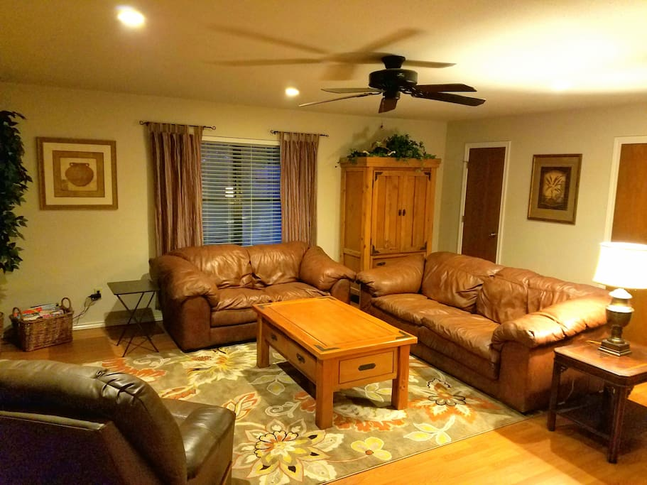 The Main living Room is spacious. TV on the wall. Built in desk with work area. Walk in closet.