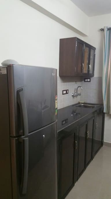 Modular kitchen loaded with fridge