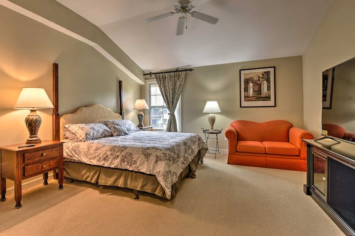 The studio includes a king bed, full bathroom, & well-equipped kitchenette.