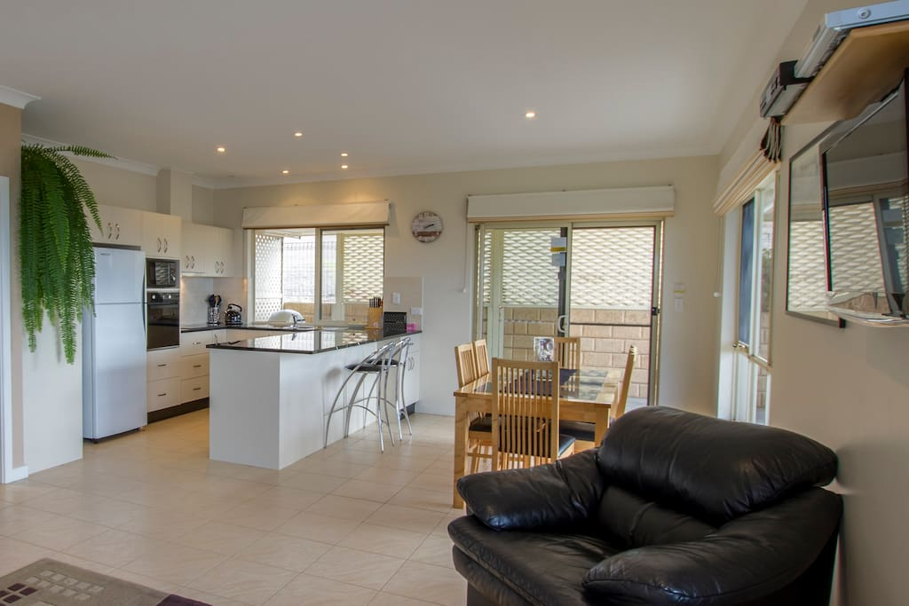 Modern spacious kitchen with full cooking facilities. and dining area