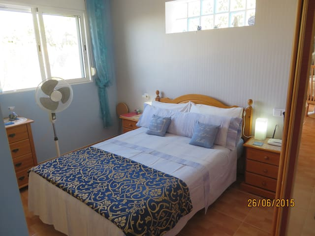 The main bedroom which faces the left side of the casita and which is very private.   Your window looks out towards the little private area and our allotment which is always locked.  So totally safe.