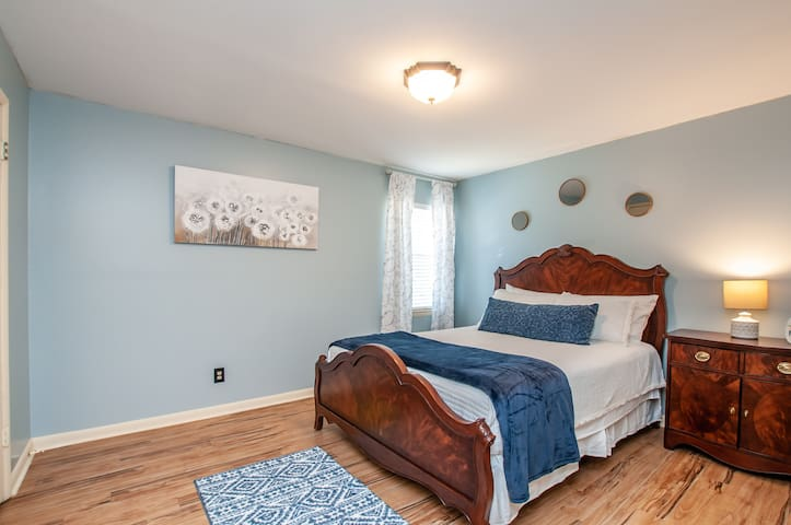 This bedroom overlooks the front of the property. We take pride in making sure our bedding is 100% sanitized to provide you the safest experience possible in our home.