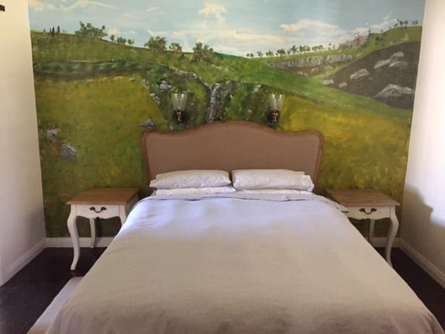 Main bedroom with mural by artist Tim Gratton