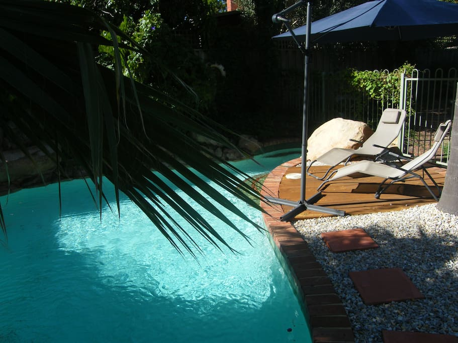 Gorgeous pool area with decking area to sunbake