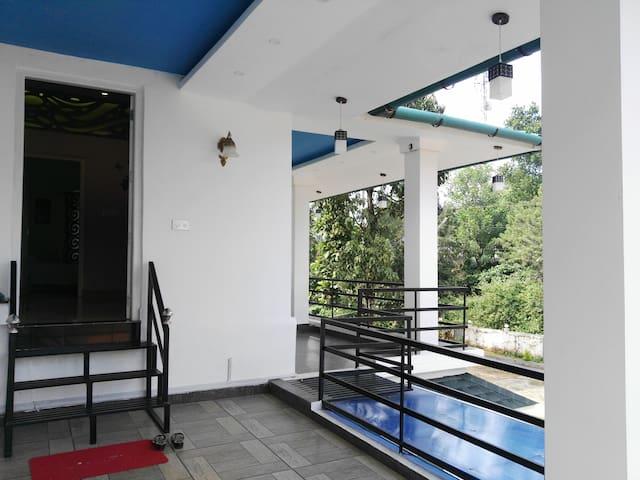 The Entrance & Balcony
