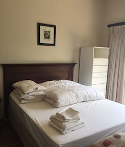 Queen size bed with shower on suite - Midrand