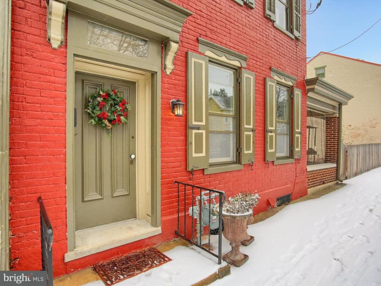 Guests enter from the front of the home. Off street parking is in the rear,next to the garages. Spring photo coming soon!