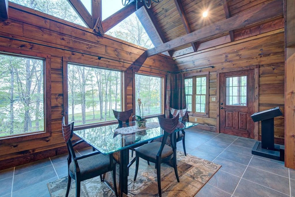 The dining room with floor to ceiling view of the lake!