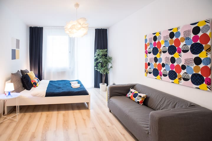 New, colourful, cozy home in center with parking