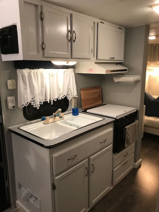 Kitchen with stove, microwave and refrigerator