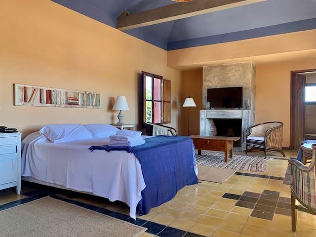 Master Suite con estufa de leña y estar con vestidor