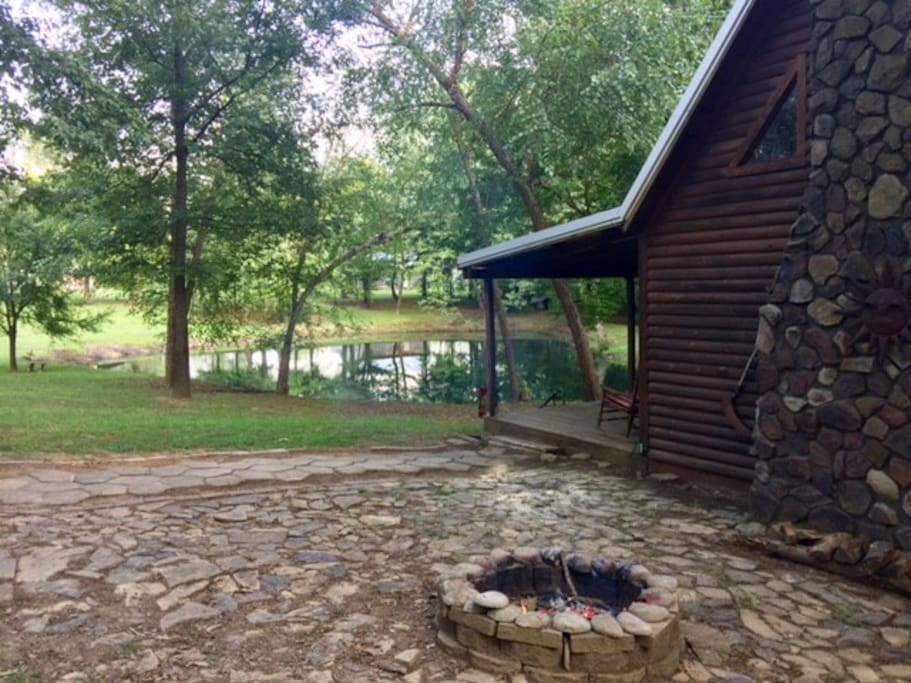 Side view of cabin and pond