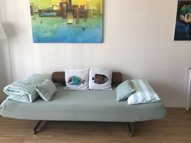 Sofa converted to comfortable Bed -  Sofa in bequemes Bett umfunktioniert