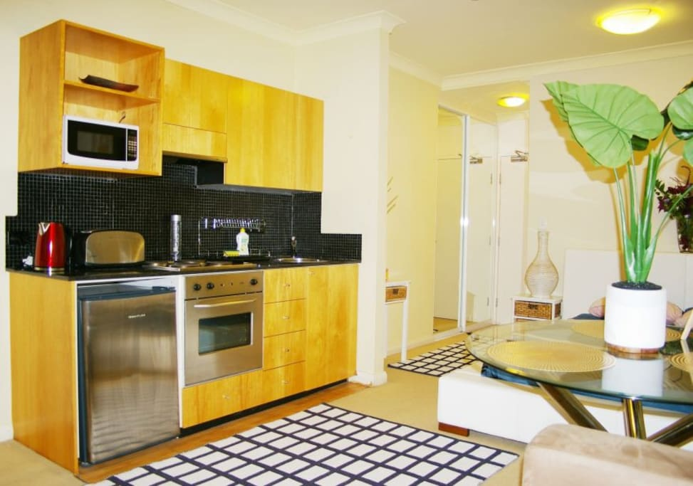 Fully equipped kitchen with cook-top stove, oven, microwave, fridge/freeze, kettle, 4 slice toaster, bowls, plates, cutlery, cups etc