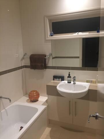 Bathroom also has a bath