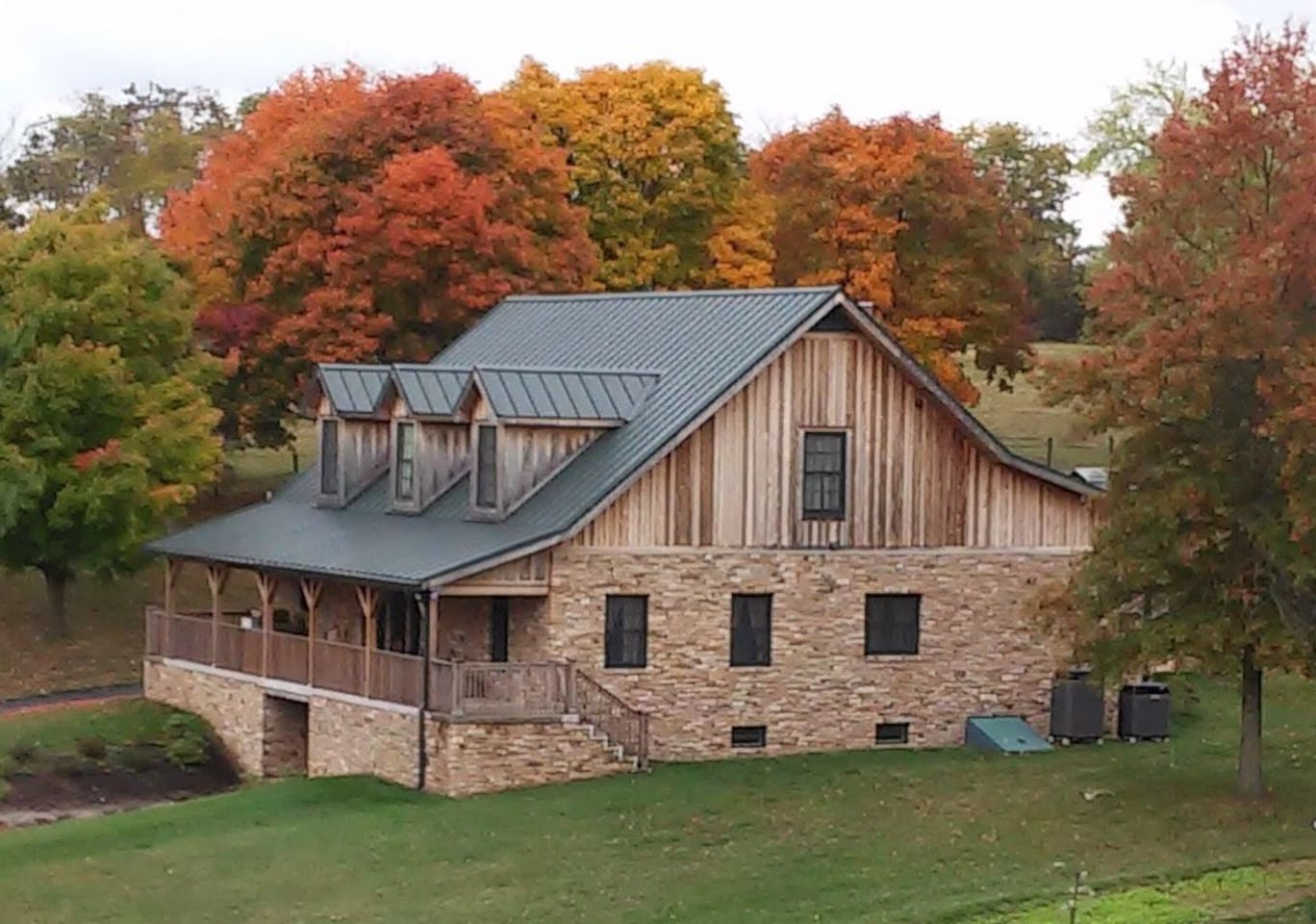 Our beautiful home pictured in the fall has a walk out basement apartment .