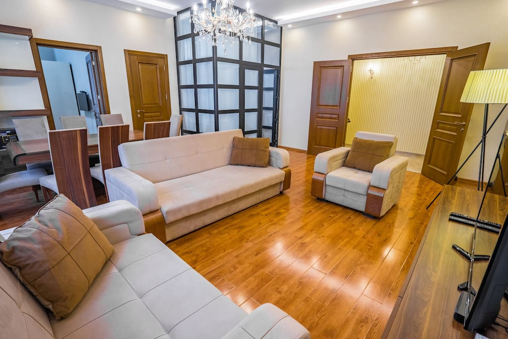 Living Room: TV, Dining area, AC