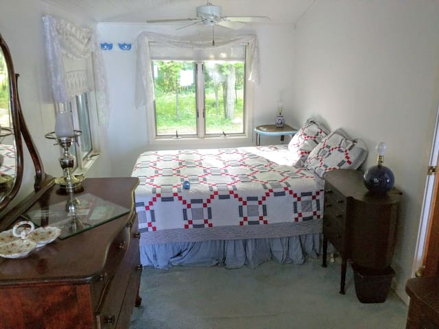 The Blue Bedroom to the south. One double bed, dresser and private entrance to porch.