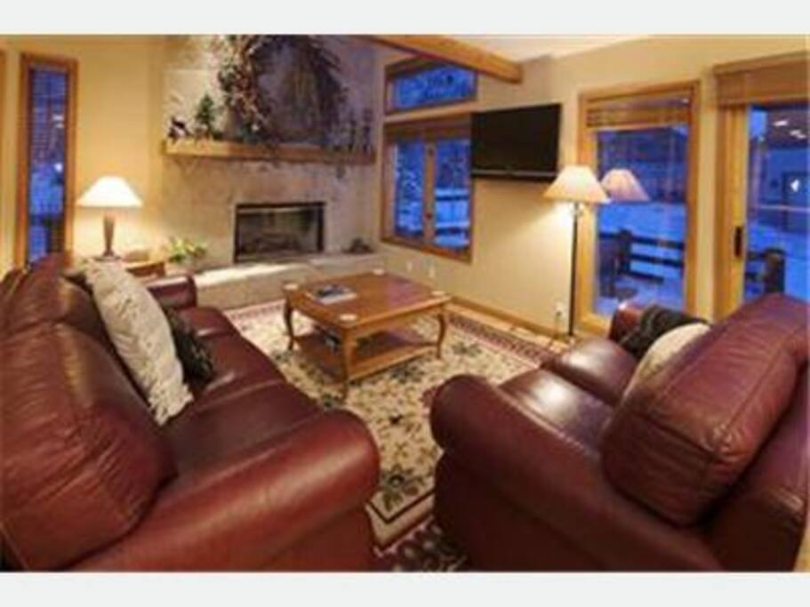 Family Room--gas fireplace, HD flat screen TV with DVD player, leather couches