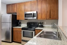 Full size kitchen with all supplies, coffee maker, pots/pans, plates, and eating utensils.