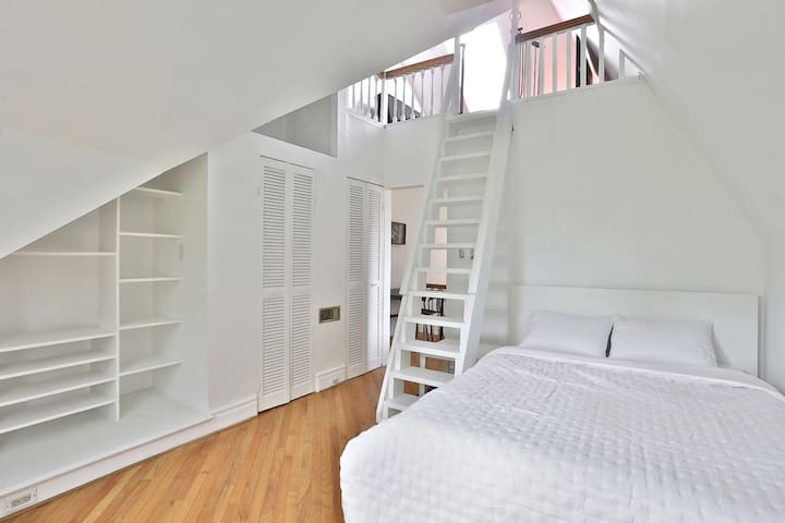 Beautiful Bedroom With Stairs Up To Loft Area