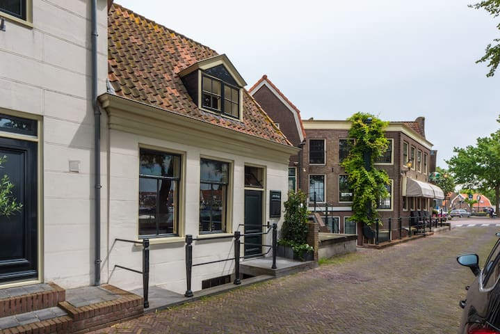Historic small harbour house in center Medemblik