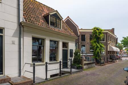 Historic small harbour house in center Medemblik