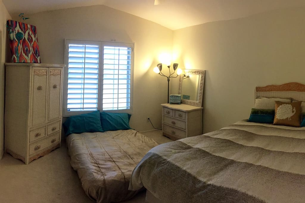 Queen bed & double, queen, & twin mattresses available. Closet space. Right off the entrance way next to a private guest bathroom.