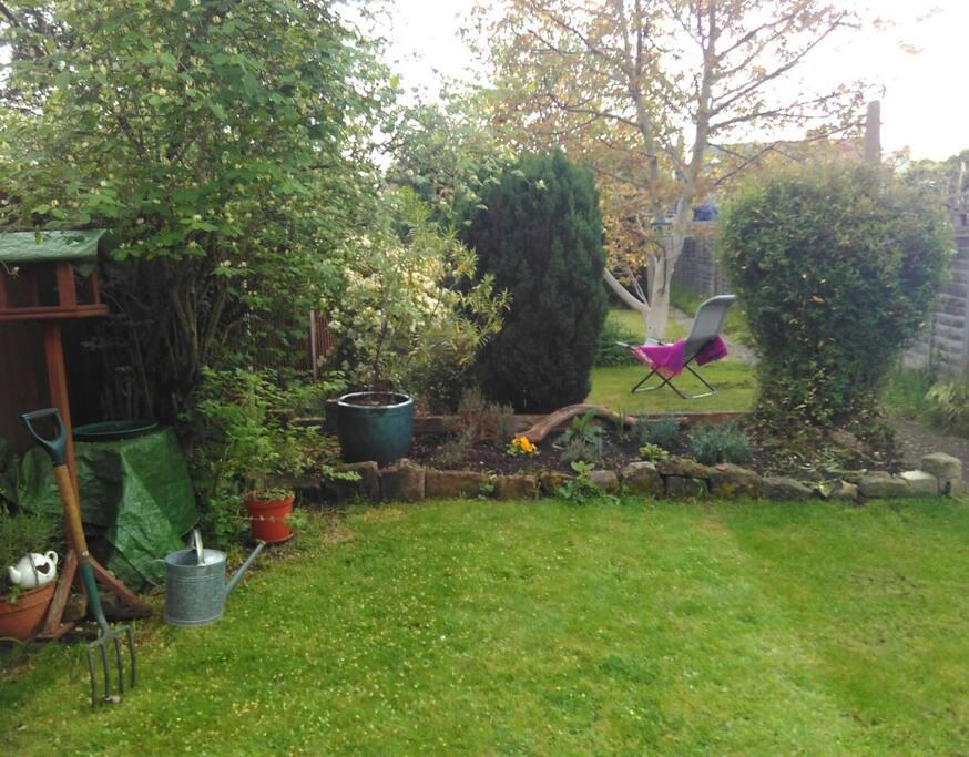 Patio garden with garden chairs, garden umbrella ect