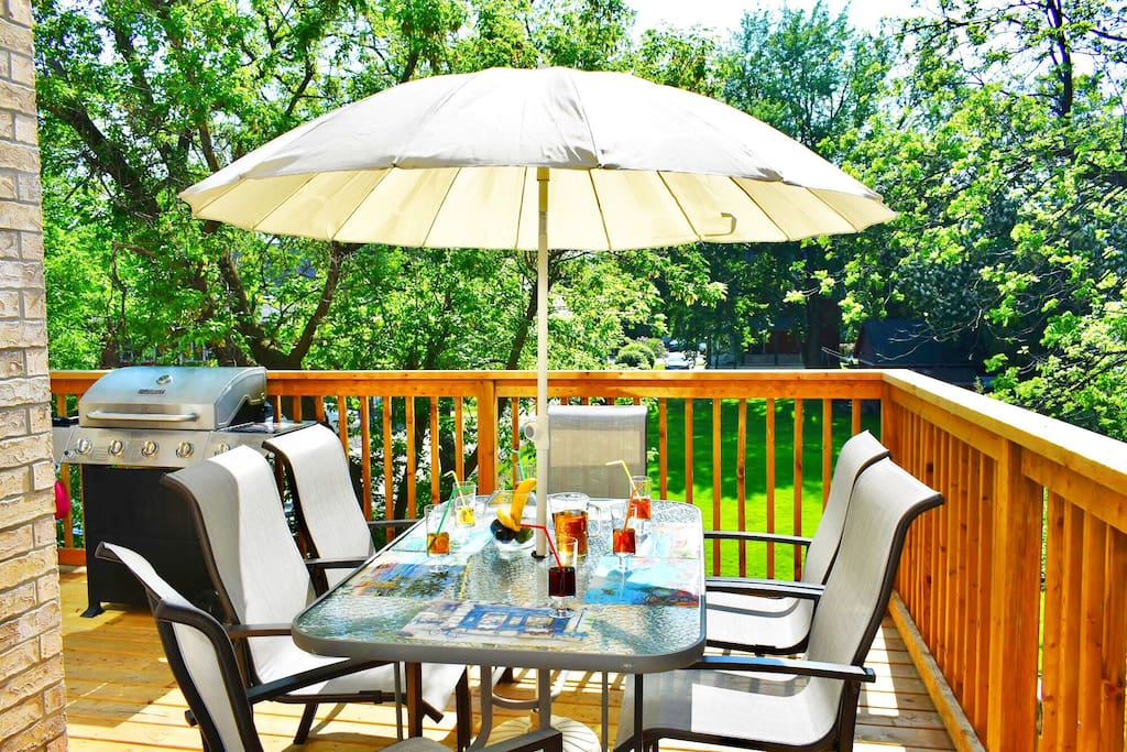 Newly built huge wooden deck with patio furniture and a BBQ Grill Master.