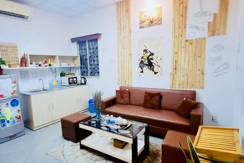 Your apt will have 2 big rooms: 1 living room, 1 bedroom and 1 bathroom. This is the living room with full amenities kitchen to make a delicious meal for your friend.