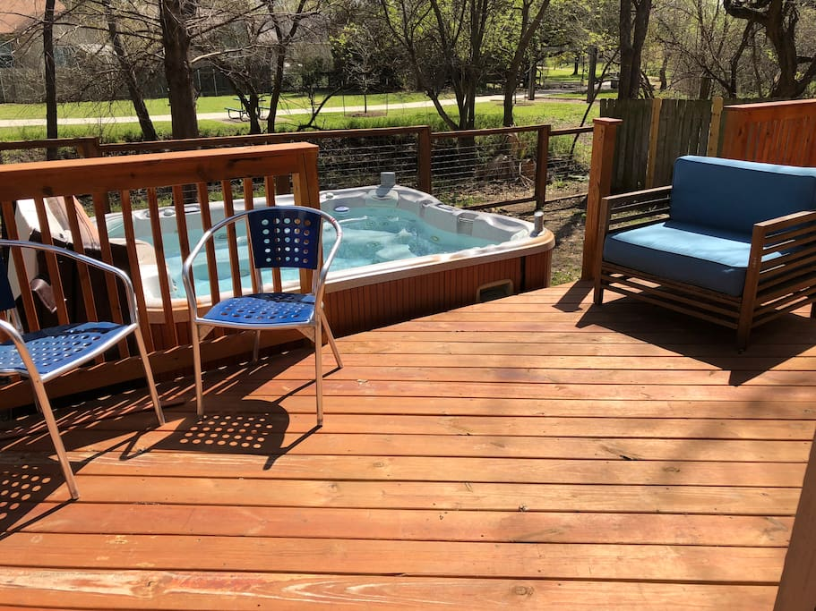 Awesome deck with hot tub in backyard