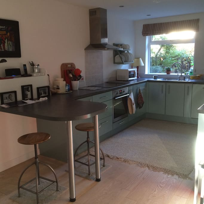 Open plan kitchen leading to dining and seating areas