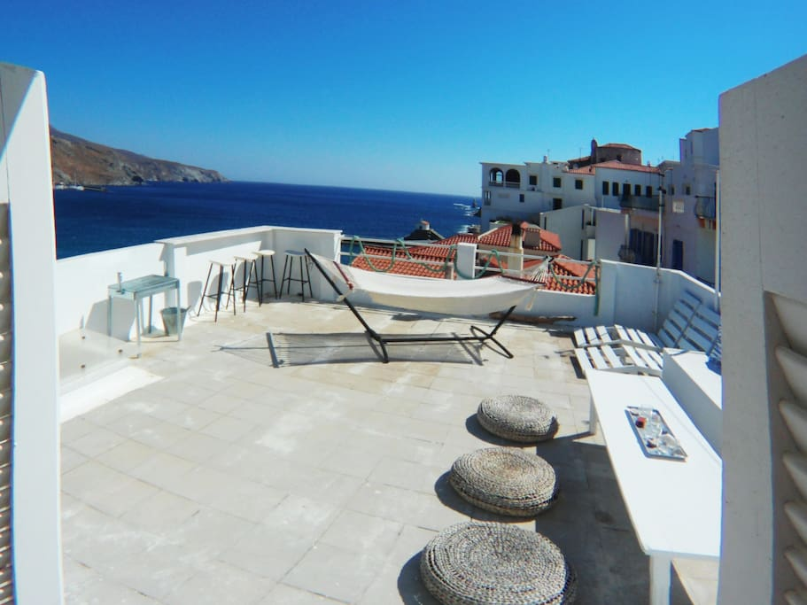 Greece, Andros, Chora - Apt#2 Private Terrace with Amazing views, outdoor shower, hammock, hanging chair, bar and lounge area.