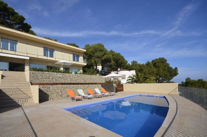 Fantastic contemporary property with sea views, located 1.5 km from the beach of Sa Tuna.