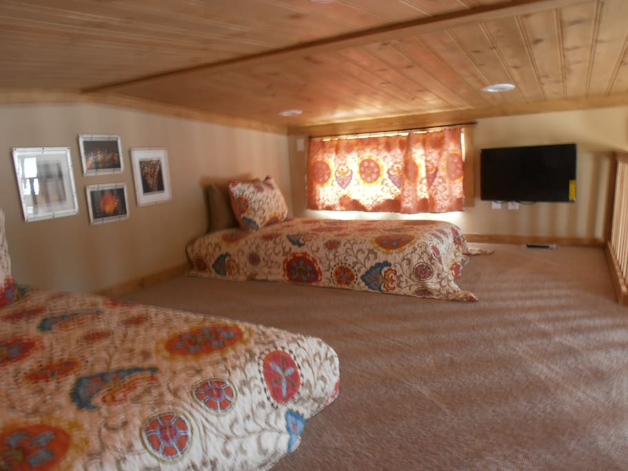 View of Loft with single beds & smart TV