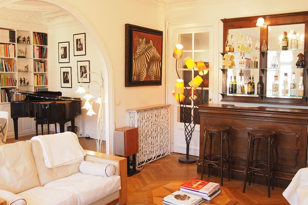 a grand piano and an authentic one century old French bistro bar
