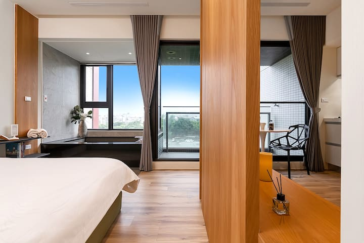 Bedroom space-Sometimes, all you need is to sit and look. Something that is irresistible within this apartment