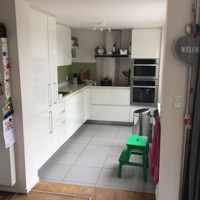 Kitchen with dishwasher, microwave and oven