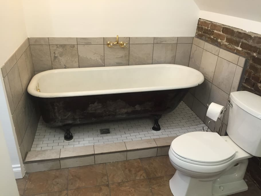 Antique 6 foot long cast iron soaking tub