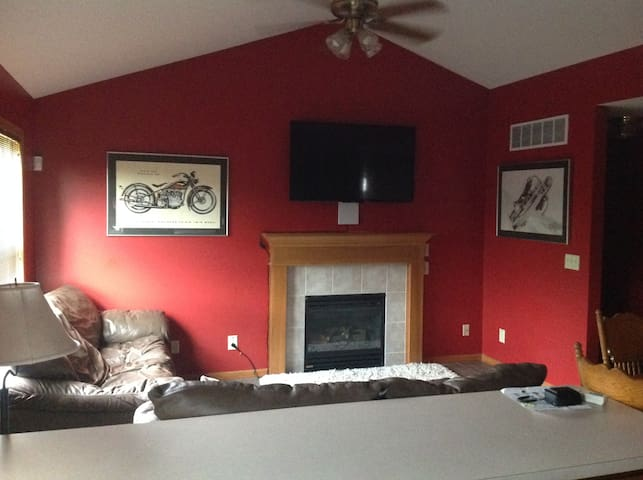"""Cozy living area, 55"""" smart TV, fireplace and two couches"""