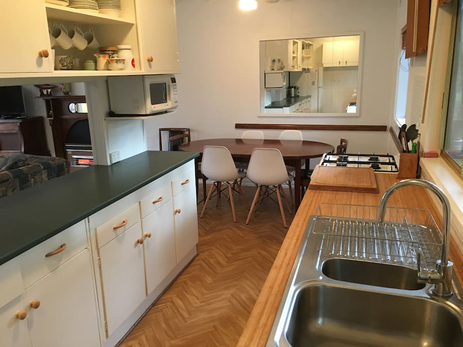 Fully equipped kitchen with full size fridge, microwave, dishwasher, oven and stove top