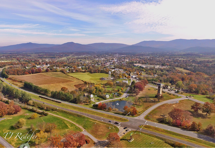 A beautiful view of the Town of Luray with the Singing Tower in the foreground and Shenandoah National Park in the distance