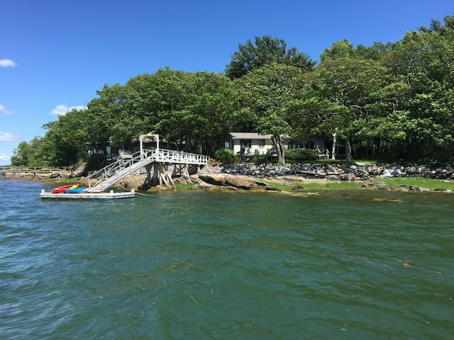 House & dock with kayaks